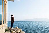 Woman enjoying the lake scenery.