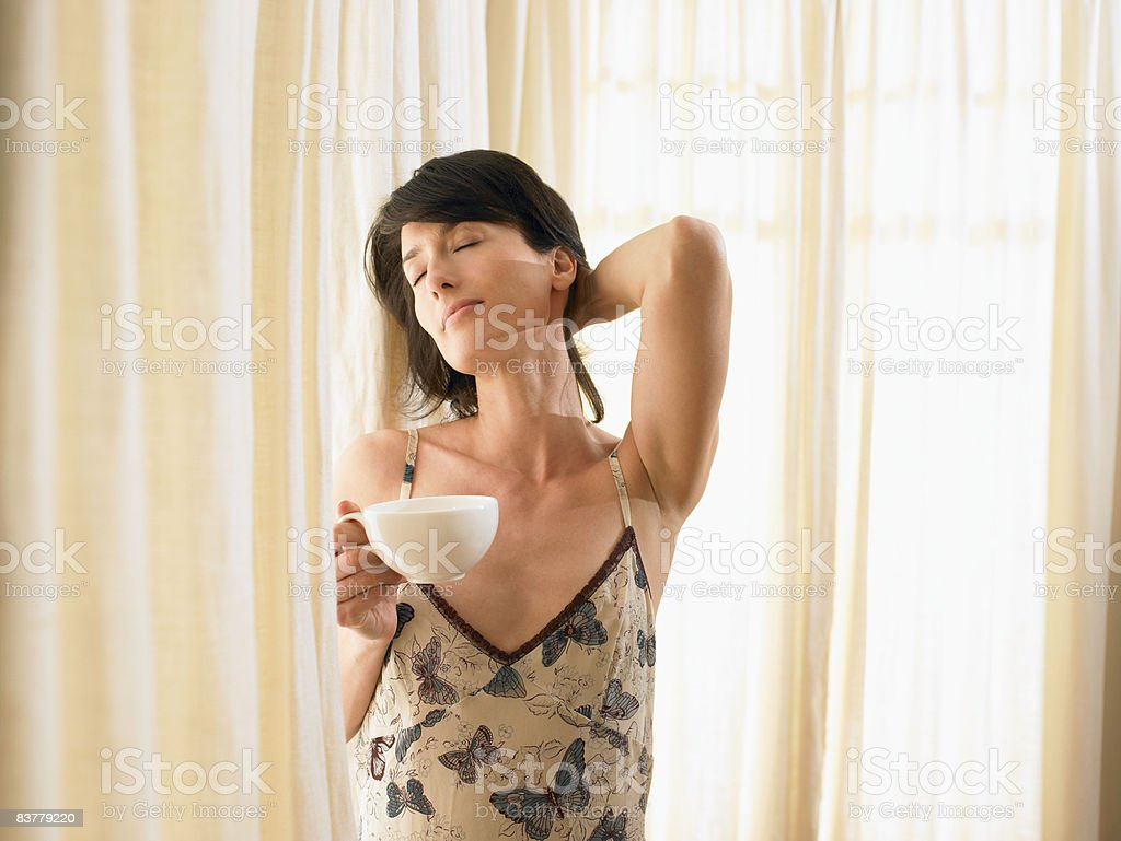 Woman enjoying the moment, holding cup royalty-free stock photo