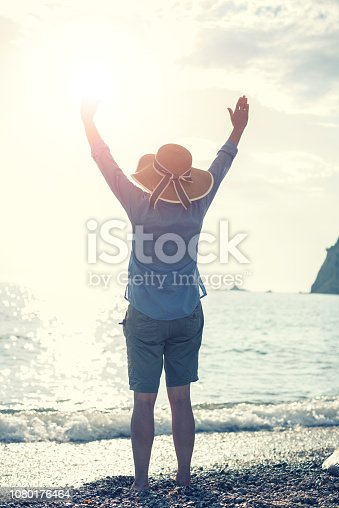Woman enjoying the nature in sunset