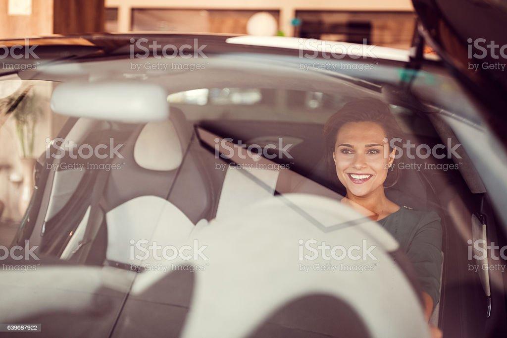 Woman enjoying the new car stock photo