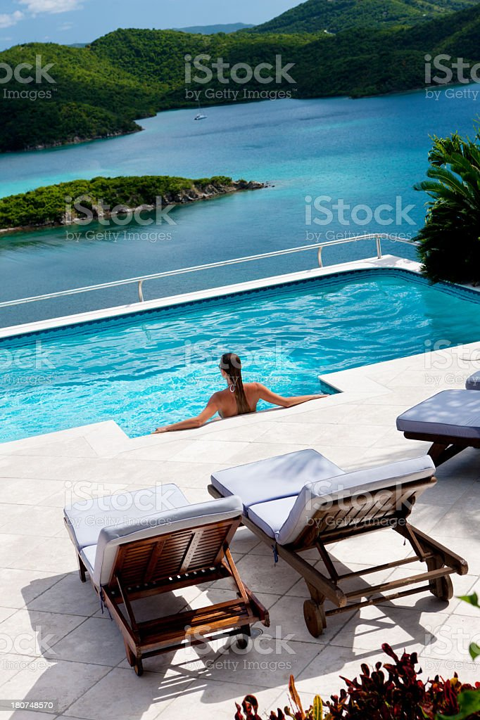 woman enjoying the pool at her Caribbean villa royalty-free stock photo