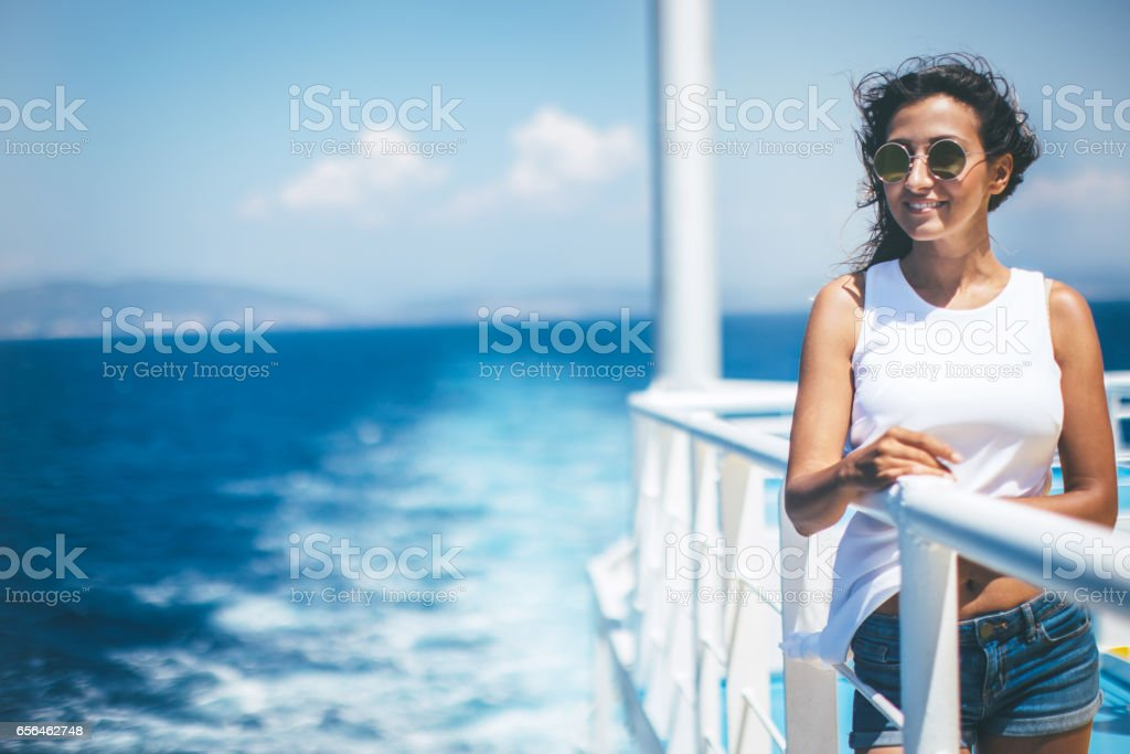 Woman enjoying the sea from cruise ship stock photo