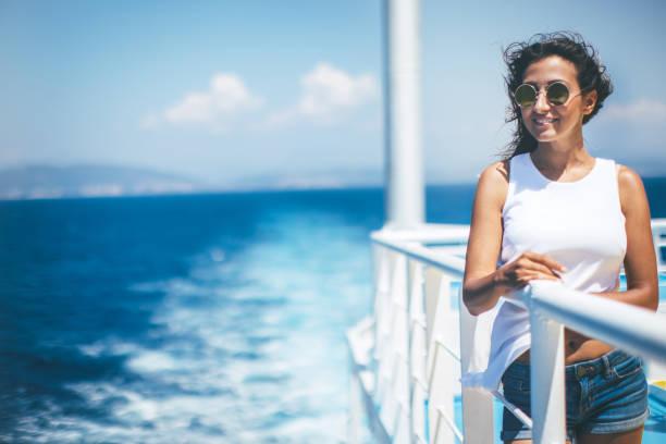 woman enjoying the sea from cruise ship - ferry imagens e fotografias de stock