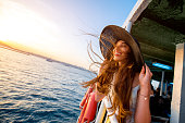Happy woman enjoying the sea from ferry boat crossing Bosphorus in Istanbul