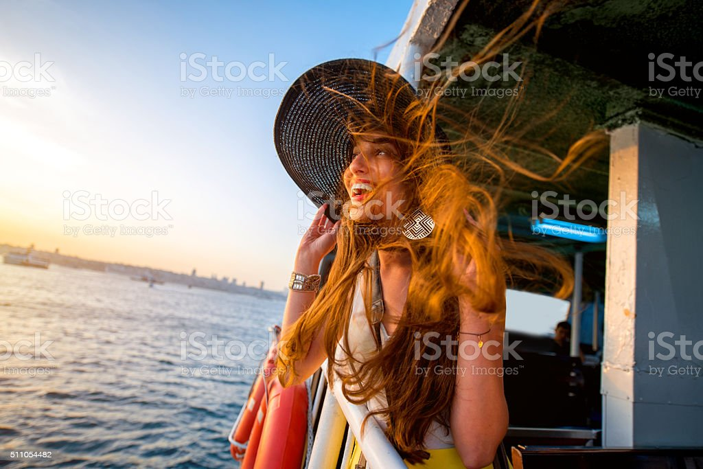 Woman enjoying the sea from ferry boat stock photo