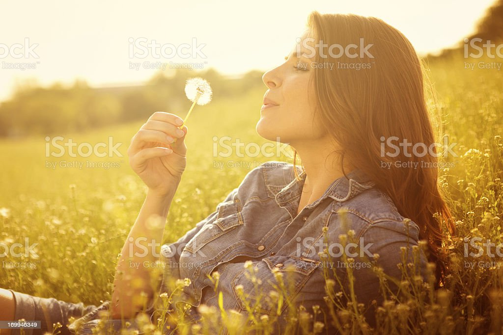 Woman enjoying the sun. stock photo