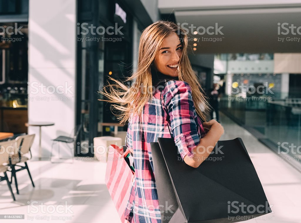 Woman enjoying the weekend in the shopping mall stock photo