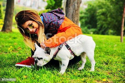 istock Woman Enjoying Time with Pet Dog 817449032