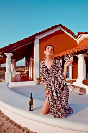 Woman Enjoying Tropical Vacation With Wine Stock Photo - Download Image Now