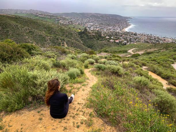 Woman enjoying view from Dartmoor Trail in Laguna Beach, CA stock photo