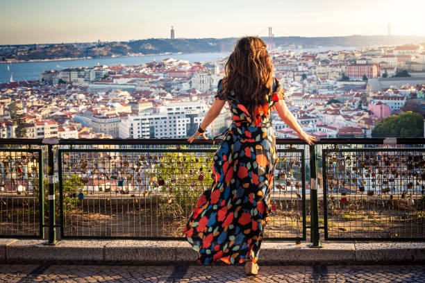 Woman enjoying view from Miradouro da Senhora do Monte in Lisbon, Portugal stock photo