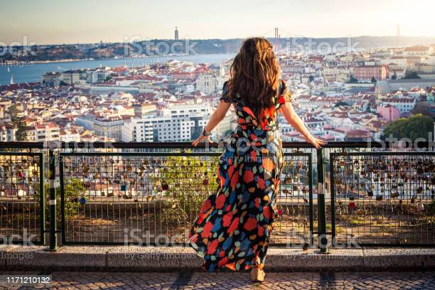 Woman Enjoying View From Miradouro Da Senhora Do Monte In Lisbon Portugal Stock Photo - Download Image Now