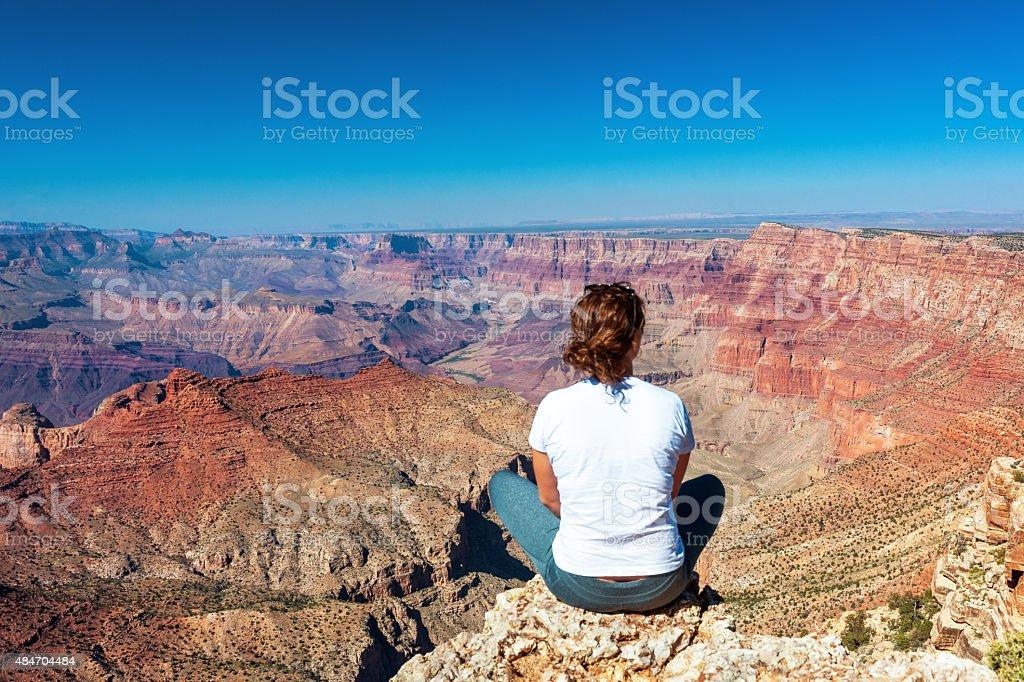 Woman Enjoying View Grand Canyon from Navajo Point,morningUSA stock photo