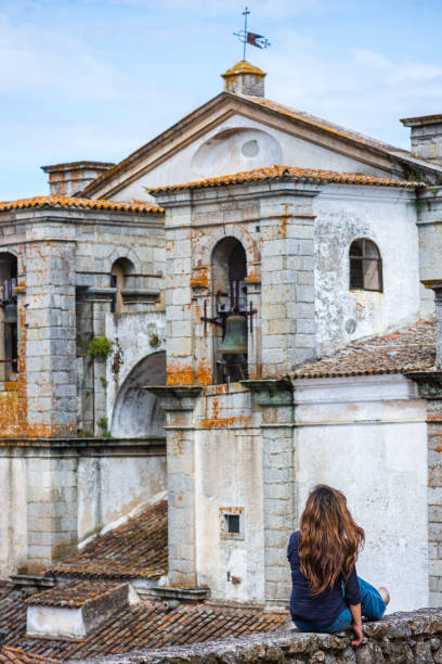 Woman enjoying view of Church of the Holy Spirit in Evora, Portugal stock photo