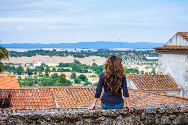 Woman enjoying view of countryside near University of Évora, Portugal stock photo
