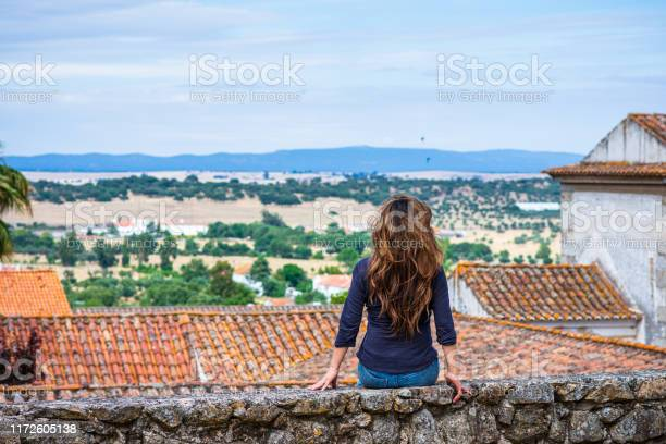 Woman Enjoying View Of Countryside Near University Of Évora Portugal Stock Photo - Download Image Now