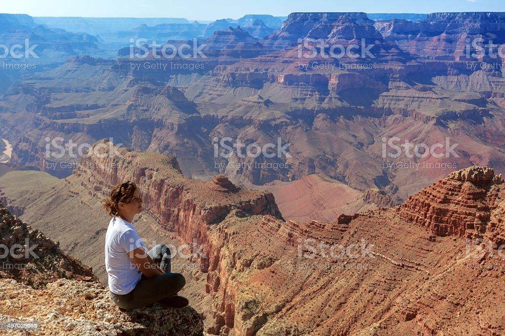 Woman Enjoying View of Grand Canyon Arizona USA stock photo
