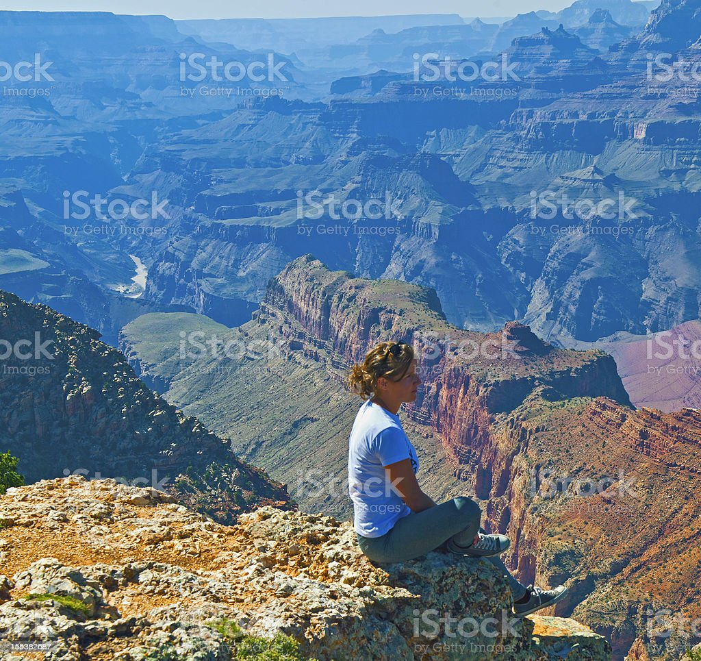 Woman Enjoying View of Grand Canyon USA royalty-free stock photo