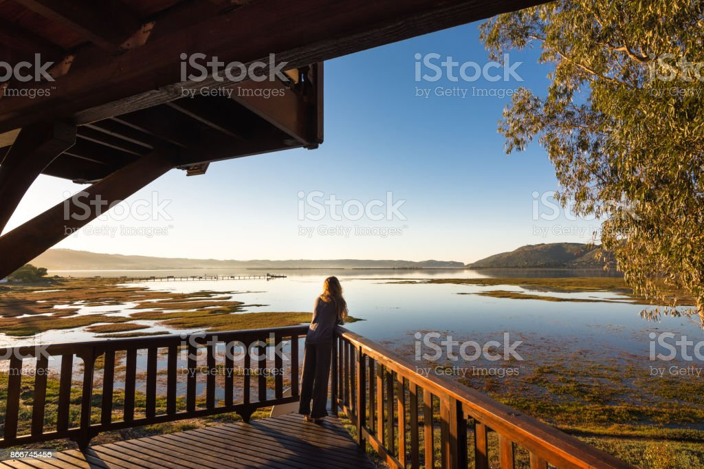Woman enjoying view overlooking Knysna lagoon in South Africa stock photo