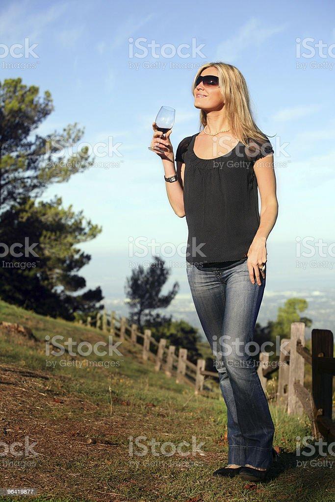Woman enjoying wine royalty-free stock photo