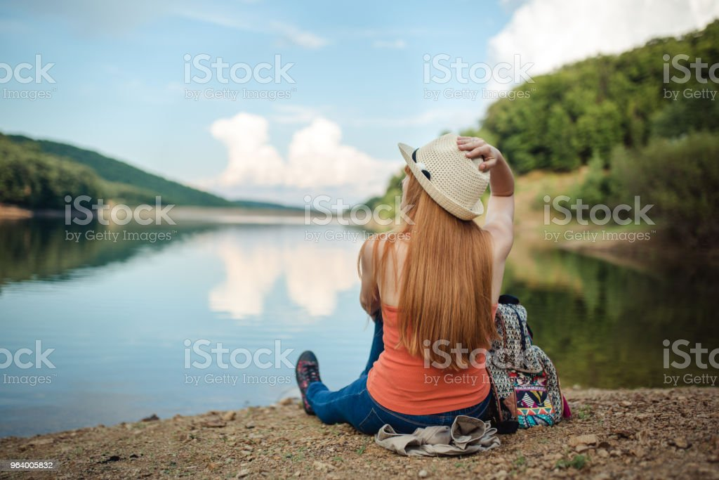 Woman enjoys by the lake - Royalty-free Adult Stock Photo