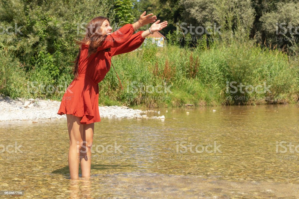 Woman enjoys her free time at the Isar river in Munich royalty-free stock photo