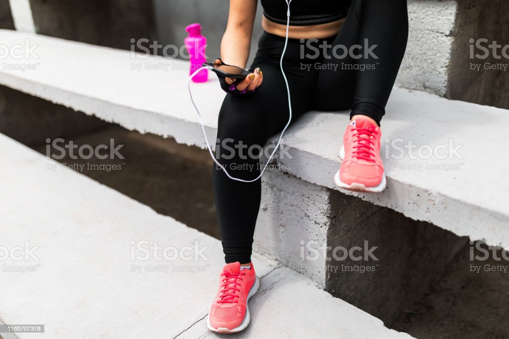 Woman enjoys in music after exercise