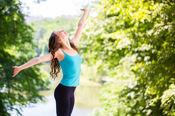 Woman enjoys outdoors. stock photo