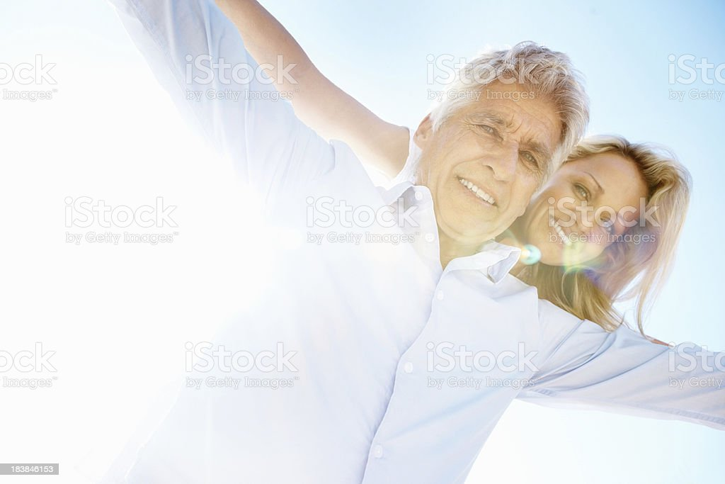 Woman enjoys piggy back ride on a sunny day royalty-free stock photo