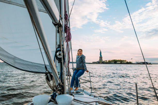Woman enjoys sailing near New York Statue of Liberty New York - discovering the beauties of this magnificent city liberty island stock pictures, royalty-free photos & images