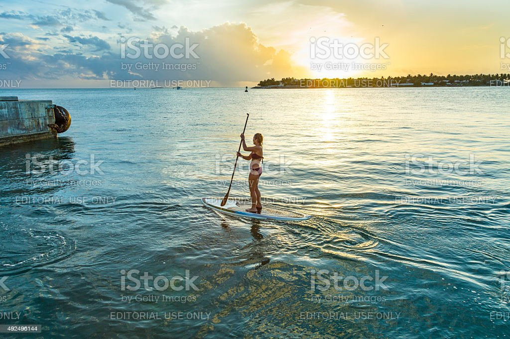 woman enjoys Stand Up Paddle Surfing in Key West stock photo