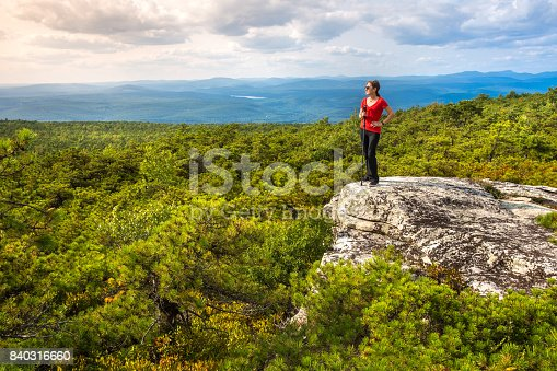 Woman enjoys the nature At High Point, on top of Shawangunk Ridge, in Upstate New York.