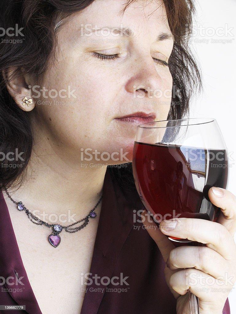 Woman enjoys wine stock photo