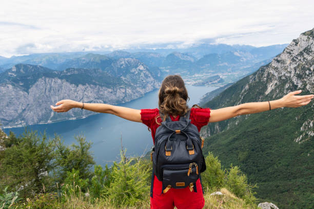 Woman enoying Lago di Garda view stock photo
