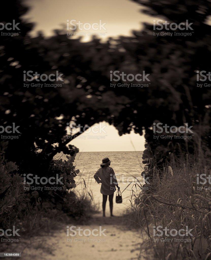woman entering beach stock photo