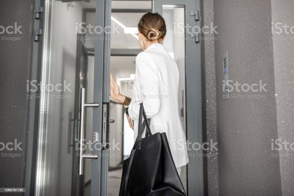 Woman entering residential building royalty-free stock photo