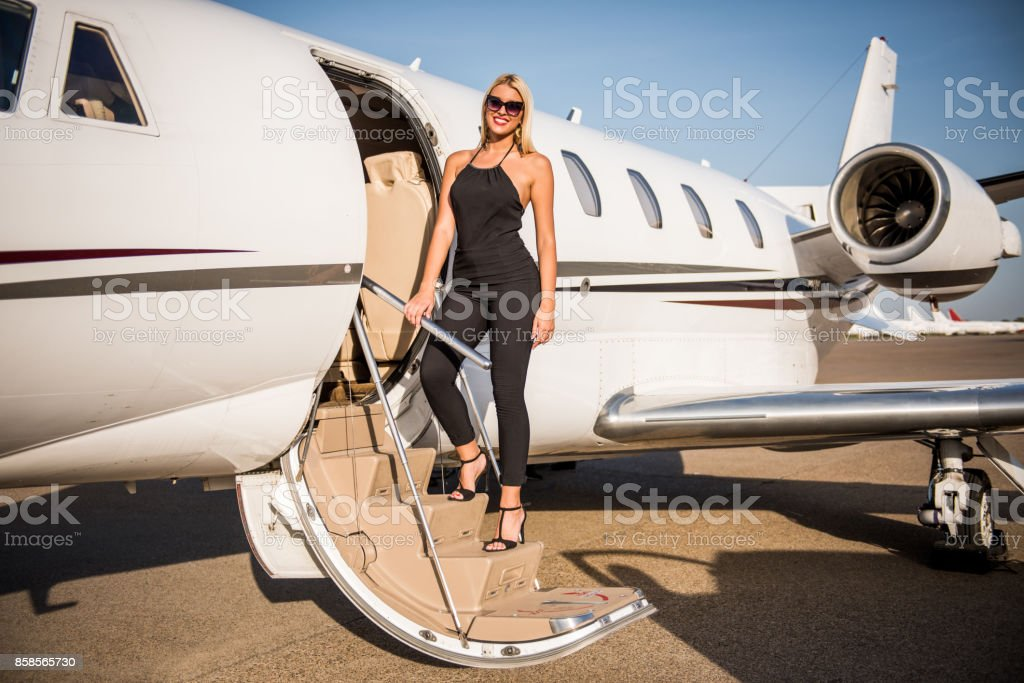 Woman entering the airplane stock photo