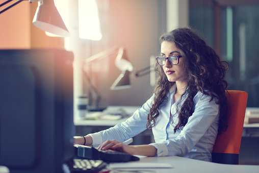 Woman Entrepreneur Busy With Her Work In Office Stock Photo - Download Image Now