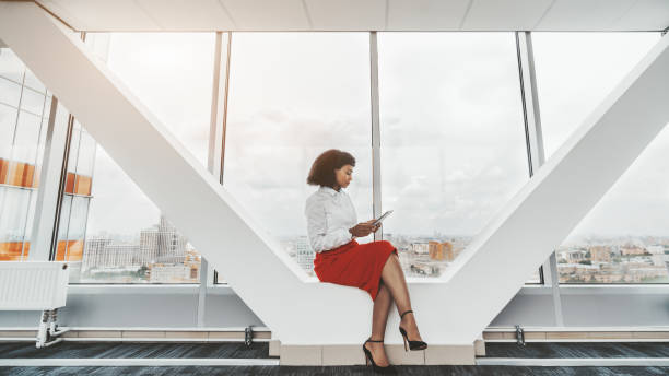 Woman entrepreneur with a tablet pc stock photo