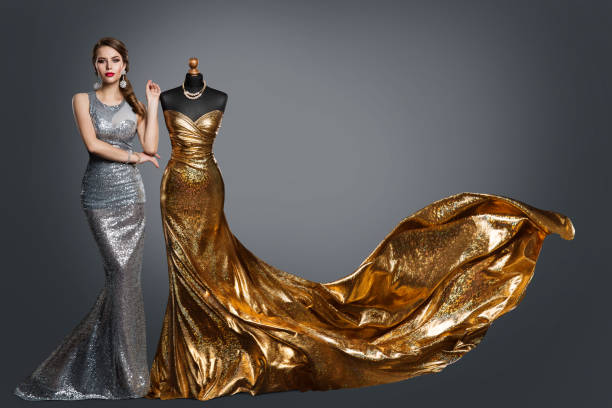 Woman Evening Dress, Fashion Gown on Tailor Dummy, Elegant Gold Silver Clothes Models stock photo
