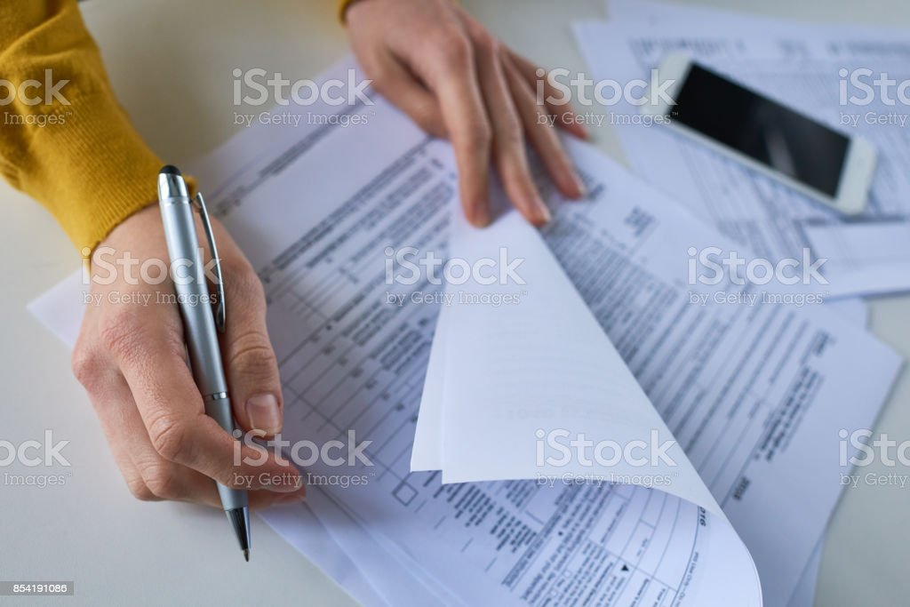 Woman examining financial papers stock photo
