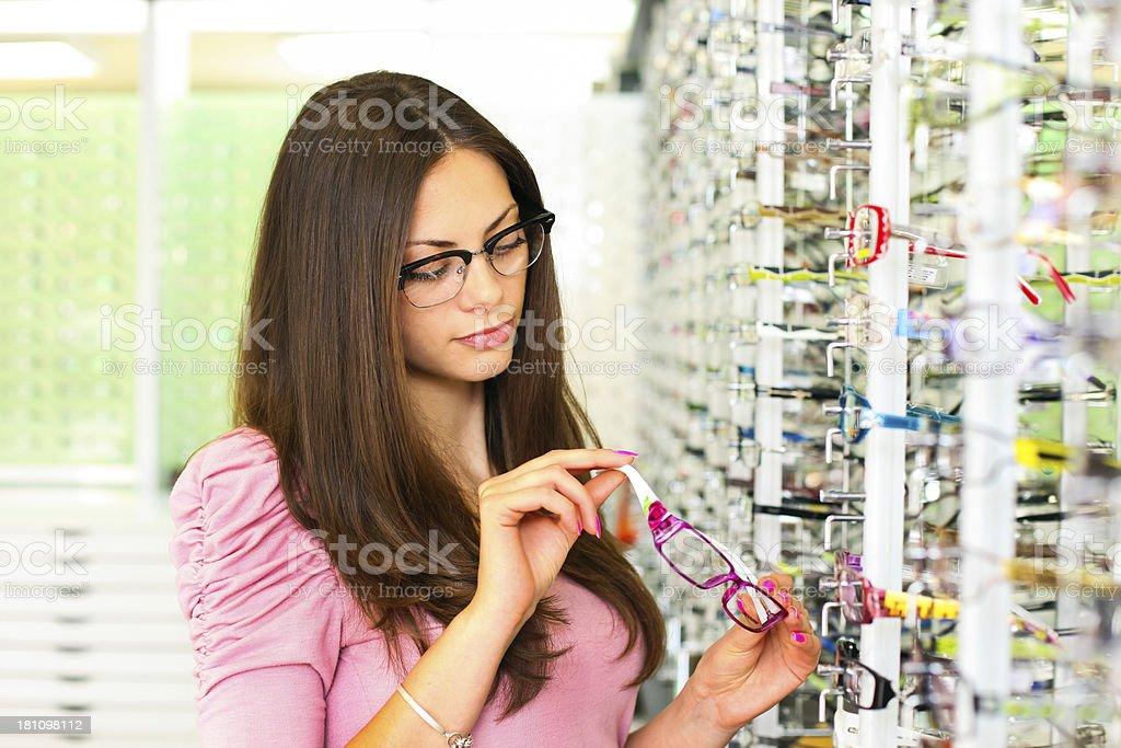 Woman examining glasses royalty-free stock photo