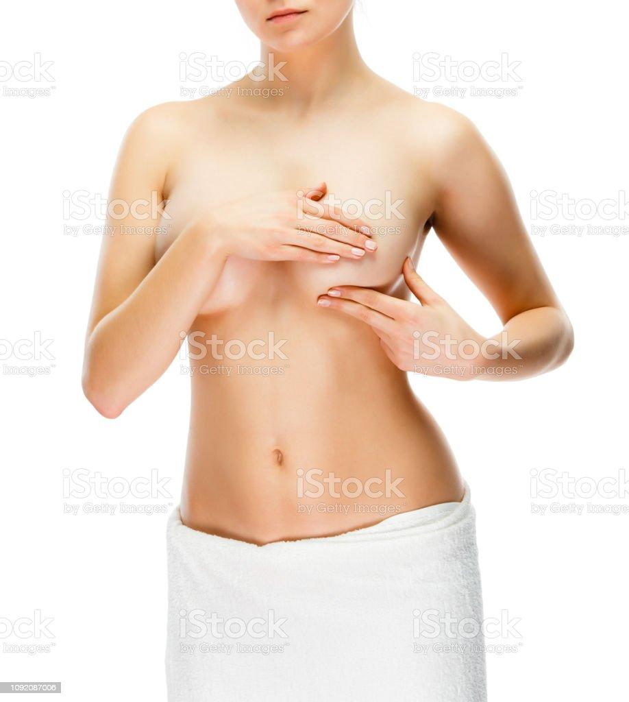Frau, untersuchen ihre Brust isoliert auf weißem Hintergrund – Foto