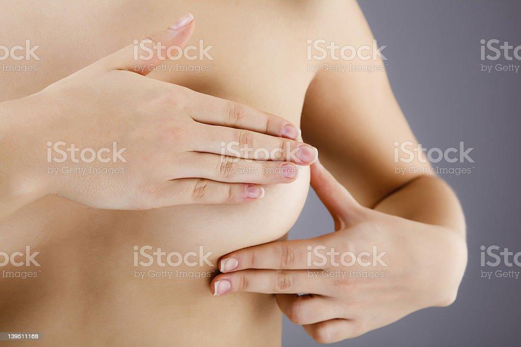 Woman examining her breast Breast examining  20-24 Years Stock Photo