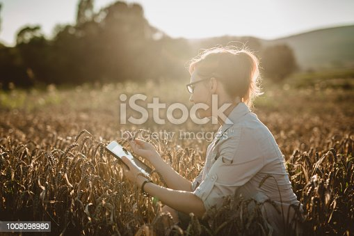 Woman scientist examining the harvest