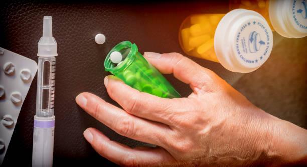 woman examining treatment of insulin, conceptual image - flu shot zdjęcia i obrazy z banku zdjęć