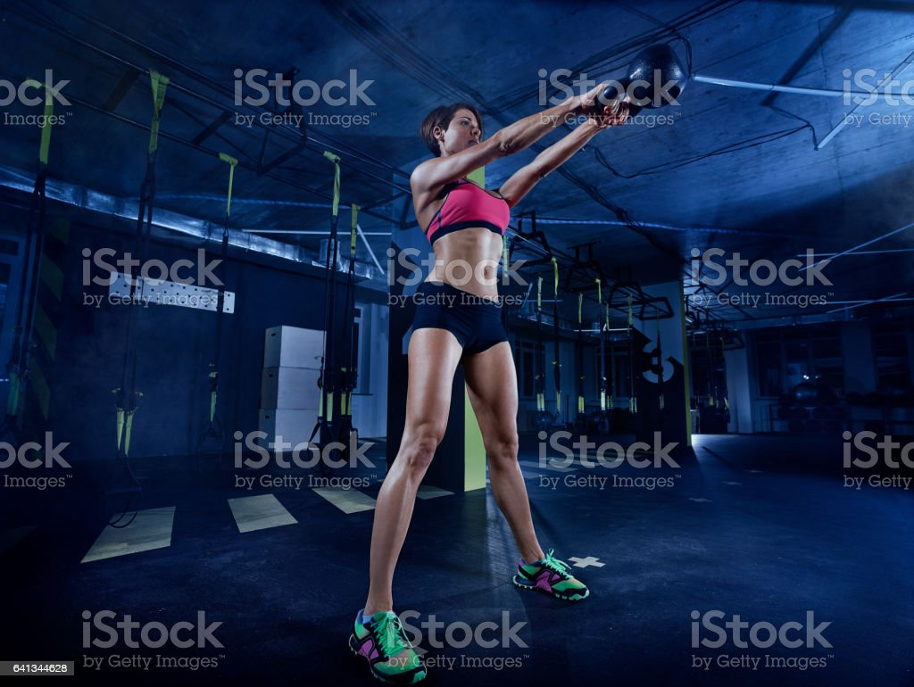 Woman exercise with kettle bell stock photo