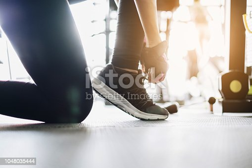 istock Woman exercise workout in gym fitness breaking relax. Athlete builder muscles lifestyle concept. 1048035444