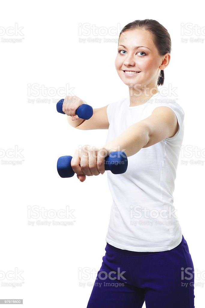 woman exercises with dumbbells royalty-free stock photo