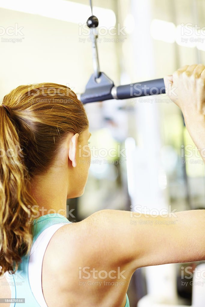 Woman exercising at fitness center stock photo